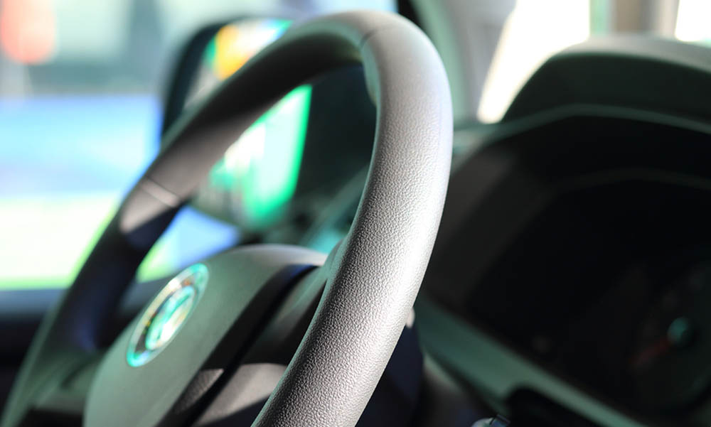 Photo of a steering wheel of a car.