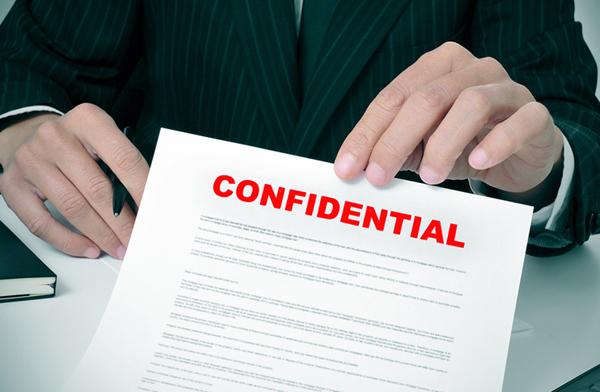 Man Holding Confidential Document